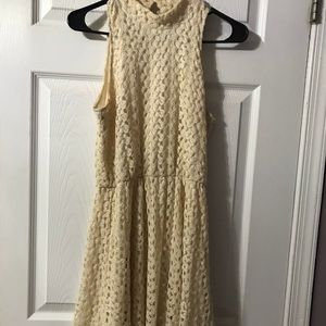 Cream colored above the knee dress